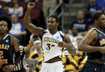 LOUISVILLE, KY - MARCH 17:  Jae Crowder #32 of the Marquette Golden Eagles celebrates the 62-53 victory against the Murray State Racers during the third round of the 2012 NCAA Men's Basketball Tournament at KFC YUM! Center on March 17, 2012 in Louisville,