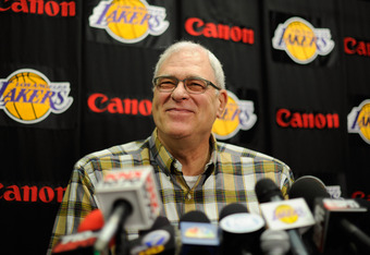 Phil Jackson will be a candidate to coach in New York but the team should wait until this season concludes.
