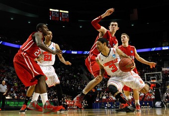 PORTLAND, OR - MARCH 15:  Peyton Siva #3 of the Louisville Cardinals drives on Jake Cohen #15 of the Davidson Wildcats in the second half in the second round of the 2012 NCAA men's basketball tournament at Rose Garden Arena on March 15, 2012 in Portland,