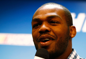 DAYTONA BEACH, FL - FEBRUARY 26:  UFC fighter Jon Jones speaks to the media prior to the start of the NASCAR Sprint Cup Series Daytona 500 at Daytona International Speedway on February 26, 2012 in Daytona Beach, Florida.  (Photo by Jonathan Ferrey/Getty I