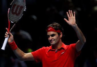 LONDON, ENGLAND - NOVEMBER 23:  Roger Federer of Switzerland celebrates after winning his men's singles match against Andy Murray of Great Britain during the ATP World Tour Finals at O2 Arena on November 23, 2010 in London, England.  (Photo by Clive Bruns