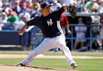 TAMPA, FL - MARCH 17:  Pitcher Hiroki Kuroda #18 of the New York Yankees pitches against the Houston Astros during a Grapefruit League Spring Training Game at George M. Steinbrenner Field on March 17, 2012 in Tampa, Florida.  (Photo by J. Meric/Getty Imag