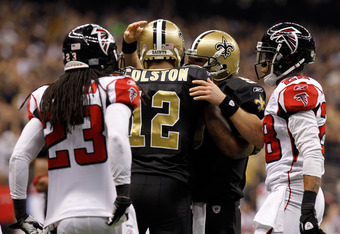 NEW ORLEANS, LA - DECEMBER 26:  Wide receiver Marques Colston #12 of the New Orleans Saints celebrates with quarterback Drew Brees #9 after Colston catches an eight-yard touchdown pass in the second quarter against the Atlanta Falcons at the Mercedes-Benz