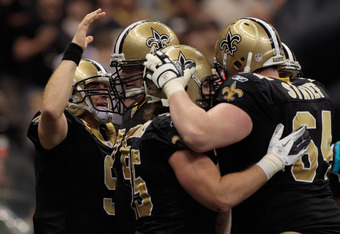 NEW ORLEANS, LA - JANUARY 01:   Drew Brees #9 of the New Orleans Saints celebrates after throwing a touchdown pass during the game against the Carolina Panthers at the Mercedes-Benz Superdome on January 1, 2012 in New Orleans, Louisiana.  The Saints defea