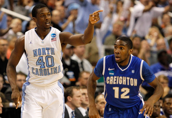 GREENSBORO, NC - MARCH 18:  Harrison Barnes #40 of the North Carolina Tar Heels reacts as he runs down court next to Jahenns Manigat #12 of the Creighton Bluejays in the first half during the third round of the 2012 NCAA Men's Basketball Tournament at Gre