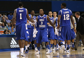 LOS ANGELES, CA - NOVEMBER 15:  James Gallman #3 of the Middle Tennessee State Blue Raiders greets teamates LaRon Dendy #1 and Shawn Jones #12 as they come off the floor during a time out against the UCLA Bruins at LA Sports Arena on November 15, 2011 in