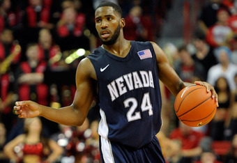LAS VEGAS, NV - NOVEMBER 14:  Deonte Burton #24 of the Nevada Reno Wolf Pack brings the ball up the court against the UNLV Rebels during their game at the Thomas & Mack Center November 14, 2011 in Las Vegas, Nevada. UNLV won 71-67.  (Photo by Ethan Miller