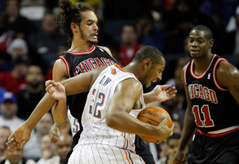 CHARLOTTE, NC - FEBRUARY 10:  Boris Diaw #32 of the Charlotte Bobcats runs into Joakim Noah #13 of the Chicago Bulls during their game at Time Warner Cable Arena on February 10, 2012 in Charlotte, North Carolina. NOTE TO USER: User expressly acknowledges