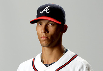 LAKE BUENA VISTA, FL - FEBRUARY 29:  Andrelton Simmons of the Atlanta Braves poses for a portrait during photo day at Champion Stadium on February 29, 2012 in Lake Buena Vista, Florida.  (Photo by Matthew Stockman/Getty Images)