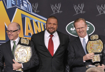 EAST RUTHERFORD, NJ - FEBRUARY 16: Woody Johnson, Triple H and John Mara attend a press conference to announce a major international event at MetLife Stadium on February 16, 2012 in East Rutherford, New Jersey. (Photo by Michael N. Todaro/Getty Images)