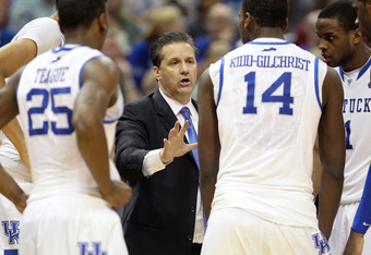 LOUISVILLE, KY - MARCH 17:  Head coach John Calipari of the Kentucky Wildcats talks with his players during a timeout in the second half against the Iowa State Cyclones during the third round of the 2012 NCAA Men's Basketball Tournament at KFC YUM! Center