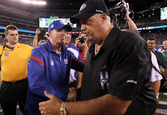 EAST RUTHERFORD, NJ - AUGUST 29:  Head coach Rex Ryan of the New York Jets greets head coach Tom Coughlin of the New York Giants after their pre season game on August 29, 2011 at MetLife Stadium in East Rutherford, New Jersey.  (Photo by Jim McIsaac/Getty