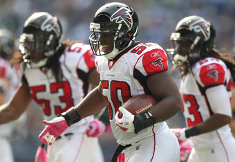 SEATTLE - OCTOBER 02:  Linebacker Curtis Lofton #50 of the Atlanta Falcons celebrates with teammates after making an interception against the Seattle Seahawks at CenturyLink Field on October 2, 2011 in Seattle, Washington. The Falcons defeated the Seahawk