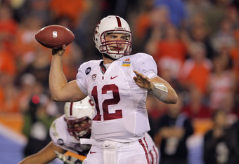 GLENDALE, AZ - JANUARY 02:  Andrew Luck #12 of the Stanford Cardinal throws a pass against the Oklahoma State Cowboys during the Tostitos Fiesta Bowl on January 2, 2012 at University of Phoenix Stadium in Glendale, Arizona.  (Photo by Doug Pensinger/Getty