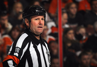 PHILADELPHIA, PA - FEBRUARY 18: Referee Paul Devorski #10 skates during the game between the Pittsburgh Penguins and the Philadelphia Flyers at the Wells Fargo Center on February 18, 2012 in Philadelphia, Pennsylvania.  (Photo by Bruce Bennett/Getty Image