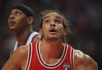 CHICAGO, IL - MARCH 12:  Joakim Noah #13 of the Chicago Bulls waits for the ball on a free-throw in front of Camelo Anthony #7 of the New York Knicks at the United Center on March 12, 2012 in Chicago, Illinois. The Bulls defeated the Knicks 104-99. NOTE T