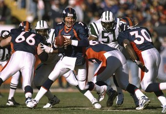 17 Jan 1999:  John Elway #7 of the Denver Broncos looks to throw  during the AFC Championship Game against the  New York Jets at Mile High Stadium in Denver, Colorado. The Broncos defeated the Jets 23-10. Mandatory Credit: Vincent Laforet  /Allsport