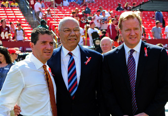 LANDOVER, MD - SEPTEMBER 11: Washington Redskins Owner Daniel Snyder (L) poses with former United States Secretary Of State Colin Powell (C) and NFL Commissioner Roger Goodell before the season opener game against the New York Giants at FedEx Field on Sep