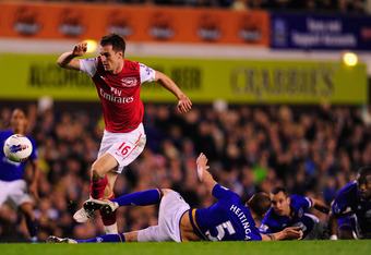 LIVERPOOL, ENGLAND - MARCH 21:  Arsenal player Aaron Ramsey skips through the Everton defence  during the Barclays Premier League match between Everton v Arsenal at Goodison Park on March 21, 2012 in Liverpool, England.  (Photo by Stu Forster/Getty Images