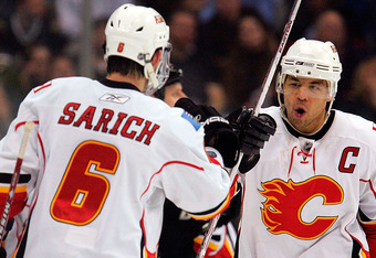 DALLAS - FEBRUARY 20:  Right wing Jarome Iginla #12 of the Calgary Flames celebrates his game winning goal with Cory Sarich #6 against the Dallas Stars at the American Airlines Center on February 20, 2008 in Dallas, Texas.  (Photo by Ronald Martinez/Getty