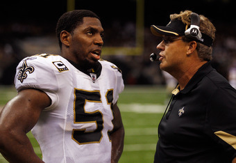 Williams (right) with linebacker Jonathan Vilma