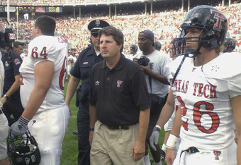 COLUMBUS, OH - AUGUST 24:  Head Coach Mike Leach of the Texas Tech Red Raiders walks on the field with his players after losing the NCAA Pigskin Classic against the Ohio State Buckeyes on August 24, 2002 at Ohio Stadium in Columbus, Ohio. Ohio State defea
