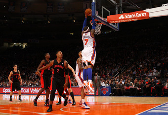 NEW YORK, NY - MARCH 20:  Carmelo Anthony #7 of the New York Knicks dunks against the Toronto Raptors at Madison Square Garden on March 20, 2012 in New York City.  NOTE TO USER: User expressly acknowledges and agrees that, by downloading and or using this