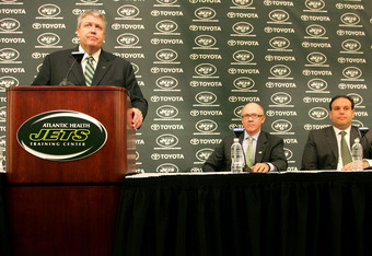 FLORHAM PARK, NJ - JANUARY 21: Rex Ryan  addresses the media during a press conference introducing him as the new Head Coach of the New York Jets as Owner Woody Johnson (C) and General Manager Mike Tannenbaum look on at the Atlantic Health Jets Training C