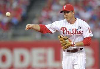 PHILADELPHIA, PA - OCTOBER 01: Chase Utley #26 of the Philadelphia Phillies throws during Game One of the National League Division Series against the St. Louis Cardinals at Citizens Bank Park on October 1, 2011 in Philadelphia, Pennsylvania. The Phillies