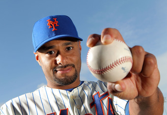 PORT ST. LUCIE, FL - MARCH 02:  Pitcher Johan Santana #57 of the New York Mets poses for photos during MLB photo day on March 2, 2012 in Port St. Lucie, Florida.  (Photo by Marc Serota/Getty Images)