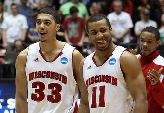 ALBUQUERQUE, NM - MARCH 17:  Rob Wilson #33 and Jordan Taylor #11 of the Wisconsin Badgers celebrate their 60-57 win over the Vanderbilt Commodores during the third round of the 2012 NCAA Men's Basketball Tournament at The Pit on March 17, 2012 in Albuque