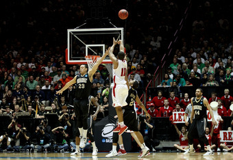 ALBUQUERQUE, NM - MARCH 17: Jordan Taylor #11 of the Wisconsin Badgers shoots against John Jenkins #23 and Kedren Johnson #2 of the Vanderbilt Commodores in the second half of the game during the third round of the 2012 NCAA Men's Basketball Tournament at