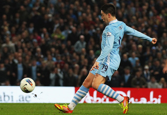 MANCHESTER, ENGLAND - MARCH 21:  Samir Nasri of Manchester City scores their second goal during the Barclays Premier League match between Manchester City and Chelsea at the Etihad Stadium on March 21, 2012 in Manchester, England.  (Photo by Alex Livesey/G