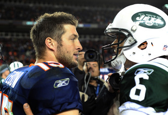 DENVER, CO - NOVEMBER 17: Tim Tebow #15 of the Denver Broncos talks with Mark Sanchez #6 of the New York Jets following the game at Sports Authority Field at Mile High on November 17, 2011 in Denver, Colorado.  (Photo by Garrett W. Ellwood/Getty Images)