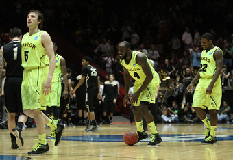 ALBUQUERQUE, NM - MARCH 17:  Brady Heslip #5, Quincy Acy #4 and A.J. Walton #22 of the Baylor Bears celebrate their 80-63 win as the Colorado Buffaloes walk off the court during against the Baylor Bears the third round of the 2012 NCAA Men's Basketball To