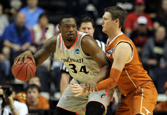 NASHVILLE, TN - MARCH 16:  Yancy Gates #34 of the Cincinnati Bearcats dribbles the ball against Clint Chapman #53 of the Texas Longhorns during the second round of the 2012 NCAA Men's Basketball Tournament at Bridgestone Arena on March 16, 2012 in Nashvil