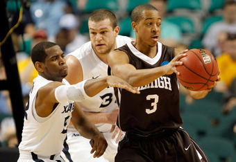 GREENSBORO, NC - MARCH 18:  C.J. McCollum #3 of the Lehigh Mountain Hawks with the ball against Tu Holloway #52 and Kenny Frease #32 of the Xavier Musketeers in the first half during the third round of the 2012 NCAA Men's Basketball Tournament at Greensbo