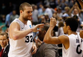 GREENSBORO, NC - MARCH 18:  Kenny Frease #32 of the Xavier Musketeers smiles late in the second half before defeating the Lehigh Mountain Hawks 70-58 during the third round of the 2012 NCAA Men's Basketball Tournament at Greensboro Coliseum on March 18, 2