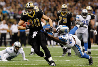 NEW ORLEANS, LA - JANUARY 07:   Jimmy Graham #80 of the New Orleans Saints runs with the ball after a catch against  Stephen Tulloch #55 of the Detroit Lions during their 2012 NFC Wild Card Playoff game at Mercedes-Benz Superdome on January 7, 2012 in New
