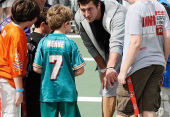 LAKE BUENA VISTA, FL - MARCH 05:  In this handout photo provided by Disney Parks, Denver Broncos Quarterback Tim Tebow huddles with young fans during a game of flag football at 'ESPN The Weekend' on March 05, 2011 at Disney's Hollywood Studios Park at Wal