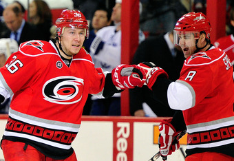 RALEIGH, NC - MARCH 03:  Jussi Jolkinen #36 celebrates with teammate Jaroslav Spacek #8 of the Carolina Hurricanes after scoring a second period goal against the Tampa Bay Lightning during play at the RBC Center on March 3, 2012 in Raleigh, North Carolina