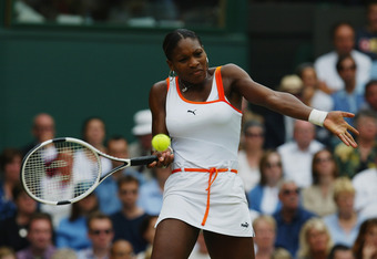 LONDON - JULY 5:  Serena Williams of the USA plays a forehand against Venus Williams of the USA in the Womens Singles Final during day twelve of the Wimbledon Lawn Tennis Championships held on July 5, 2003 at the All England Lawn Tennis and Croquet Club,