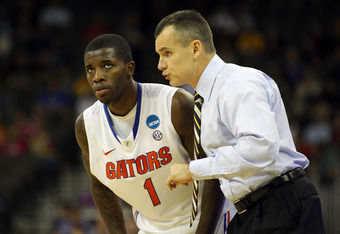 OMAHA, NE - MARCH 16:  Head coach Billy Donovan of the Florida Gators talks with Kenny Boynton #1 against the Virginia Cavaliers during the second round of the 2012 NCAA Men's Basketball Tournament at CenturyLink Center on March 16, 2012 in Omaha, Nebrask