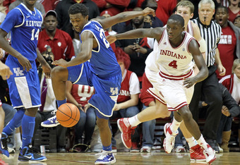 BLOOMINGTON, IN - DECEMBER 10:  Victor Oladipo #4 of the Indiana Hoosiers and Doron Lamb #20 of the Kentucky Wildcats battle for a loose ballduring the Indiana 73-72 victory at Assembly Hall on December 10, 2011 in Bloomington, Indiana.  (Photo by Andy Ly