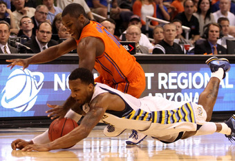 PHOENIX, AZ - MARCH 22:  Todd Mayo #4 of the Marquette Golden Eagles and Erving Walker #11 of the Florida Gators go after a loose ball in the second half during the 2012 NCAA Men's Basketball West Regional Semifinal game at US Airways Center on March 22,