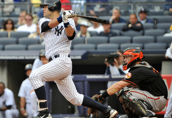 NEW YORK, NY - SEPTEMBER 07: Jesus Montero #63 of the New York Yankees watches his two run single in the bottom of the fourth inning against the Baltimore Orioles on September 7, 2011 at Yankee Stadium in the Bronx borough of New York City. (Photo by Chri