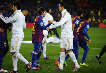 BARCELONA, SPAIN - JANUARY 25:  Lionel Messi of FC Barcelona (L) shakes hands with Cristiano Ronaldo of Real Madrid prior to the Copa del Rey quarter final second leg match between FC Barcelona and Real Madrid at Camp Nou on January 25, 2012 in Barcelona,