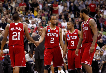 COLUMBUS, OH - MARCH 18: C.J. Williams #21, Lorenzo Brown #2, Alex Johnson #3 and Richard Howell #1 of the North Carolina State Wolfpack react after a play late in the game against the Georgetown Hoyas during the third round of the 2012 NCAA Men's basketb