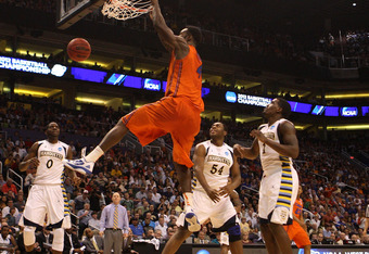 PHOENIX, AZ - MARCH 22:  Patric Young #4 of the Florida Gators dunks the ball in the first half against the Marquette Golden Eagles during the 2012 NCAA Men's Basketball West Regional Semifinal game at US Airways Center on March 22, 2012 in Phoenix, Arizo