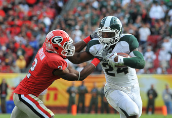 TAMPA FL - JANUARY 02: Running back Le'Veon Bell #24 of the Michigan State Spartans rushes upfield against the Georgia Bulldogs in the Outback Bowl January 2, 2012 at Raymond James Stadium, Tampa, Florida. The Spartans won 33 - 30. (Photo by Al Messerschm